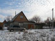 Дачный дом с мансардой и гаражом на участке 12 сот.